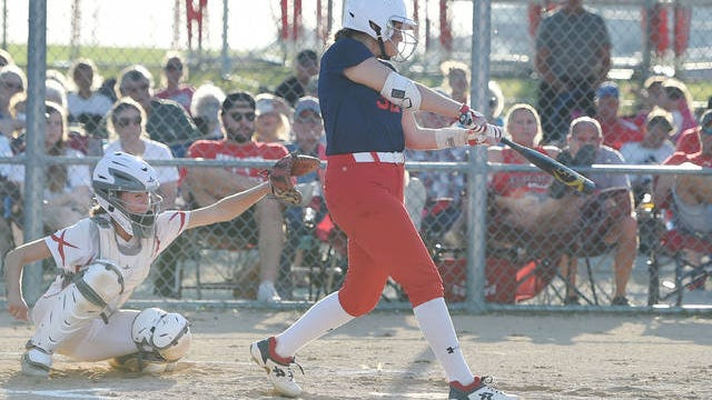 Ballard's Matty Beerbower hits the ball for a double as Boone's catcher Zoey Hightshoe attempts to catch the ball during the third inning in the Class 4A regional tournament at Ballard Softball field on Thursday, July 16, in Huxley. Photo by Nirmalendu Majumdar