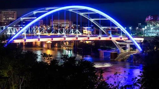 Blue lights light up the Korean War Veterans Memorial Bridge in Nashville on April 9.