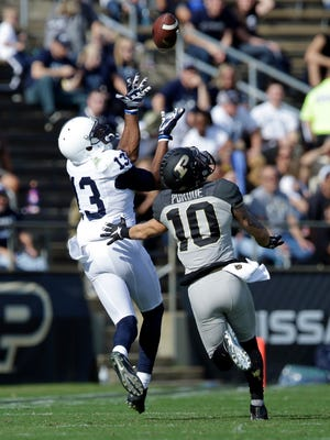 Penn State wide receiver Saeed Blacknall (13) makes a catch over Purdue defensive end Gelen Robinson (13) for a 42-yard gain during the second half. Penn State defeated Purdue 62-24.