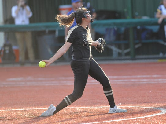 Clyde's Kaitlyn Turner (5) throws a pitch during the