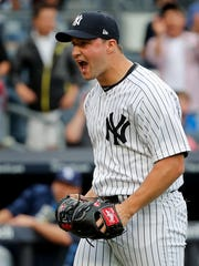 New York Yankees relief pitcher Tommy Kahnle reacts