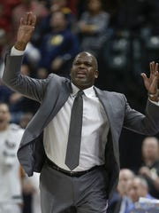 Indiana Pacers head coach Nate McMillan argues a call with an official in the second half of their game at Bankers Life Fieldhouse, Friday, Nov 17, 2017. The Indiana Pacers defeated the Detroit Pistons 107-100.