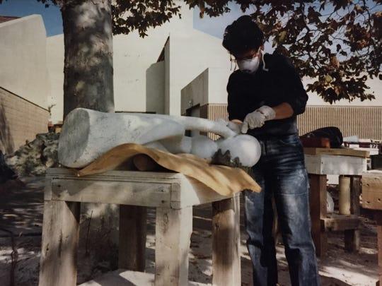 Joy Taylor works in her outdoor studio in Newport Beach, circa 1990s.