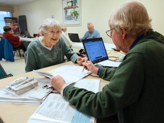 Lois Ryan, 72, of Middletown, has her taxes done at the Middletown Odessa Townsend Senior Center by volunteer Brian Read, a retired engineer from Newark.