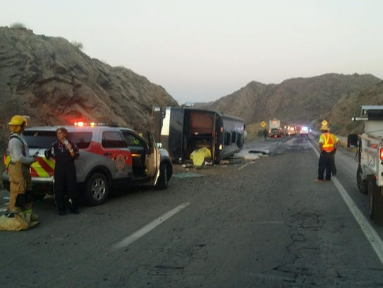 Tour bus driver dies, 8 injured in early-morning crash ...