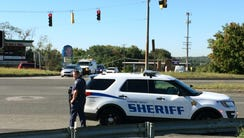 Police respond to a shooting at a business park in