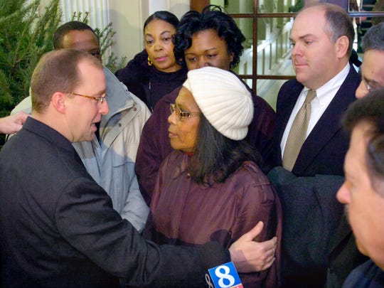 York Mayor John Brenner tells Hattie Dickson, Lillie Belle Allen's sister, that 'we are sorry for your loss' during a news conference Dec. 6, 2005, after the city settled a civil rights lawsuit with Allen's family.