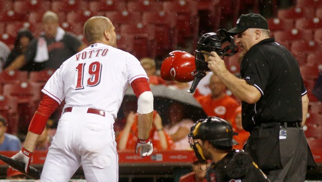 Cincinnati Reds first baseman Joey Votto (19) argues with home plate umpire Bill Welke (right) after Votto was ejected from the game against the Pittsburgh Pirates in the eighth inning at Great American Ball Park.