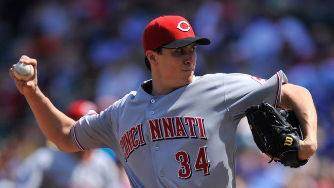 Cincinnati Reds starter Homer Bailey delivers a pitch during the first inning of a baseball game against the Chicago Cubs in Chicago Sunday.