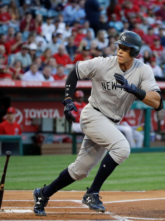 New York Yankees' Aaron Judge runs to first base on a passed ball by Los Angeles Angels catcher Martin Maldonado during the first inning of a baseball game, Tuesday, June 13, 2017, in Anaheim, Calif. (AP Photo/Jae C. Hong)