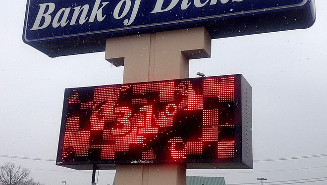 Snow flurries fell throughout Dickson County and the Midstate Tuesday morning. Pictured, flurries fall around the Bank of Dickson sign, which flashes the unusually low late March temperature.
