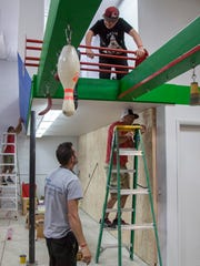 People work Wednesday, Aug. 9, 2017 on building the exercise equipment at The Grip, an American Ninja Warrior-themed gym that will open Sept. 9 in Washington City. The Grip is owned by three local competitors on the TV show; Jon Stewart, Brian Beckstrand and John Merrihew.