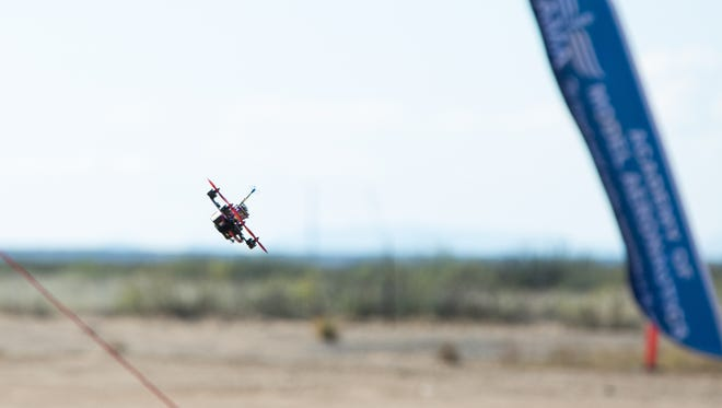 One of the many drones speeds through the drone race course at the Spaceport America Drone Summit, Saturday November 12, 2016. The drone races are one part of the summit, that included vendors and workshops related to drone flying and education.