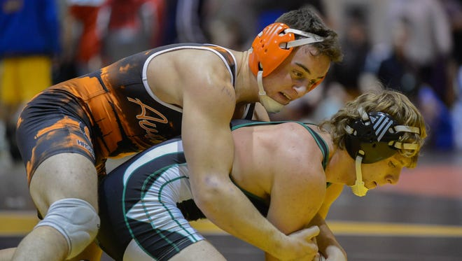Hasbrouck Heights senior John Iurato (top) against New Milford senior Dane Terry in the 152-pound preliminary round bouts at the BCCA George Jockish Holiday Wrestling Tournament on Dec. 26, 2016 at Hackensack High School.