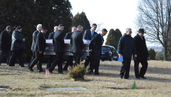 Members of the Delaware State Police Honor Guard help