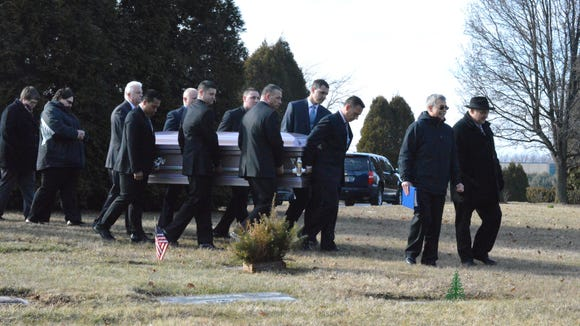 Members of the Delaware State Police Honor Guard help carry the casket of Valeria V. Mayer during her services Friday at All Saints Cemetery.