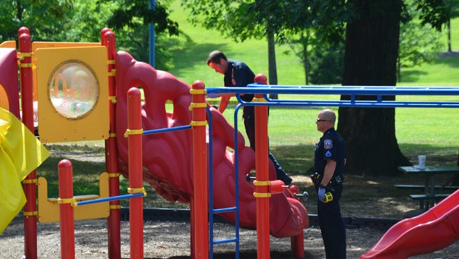 Wilmington police are investigating a body found on a slide in Canby Park.