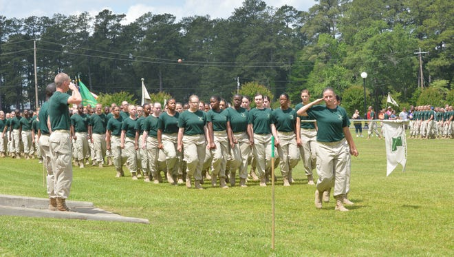 Youth Challenge Program cadets, led by Leah Gaspard (right) of Leesville, march in a pass-in review ceremony at Family Day at Camp Beauregard last year. Family Day for the current cadets is set for 11:30 a.m. Sunday at Camp Beauregard on the Parade Field.