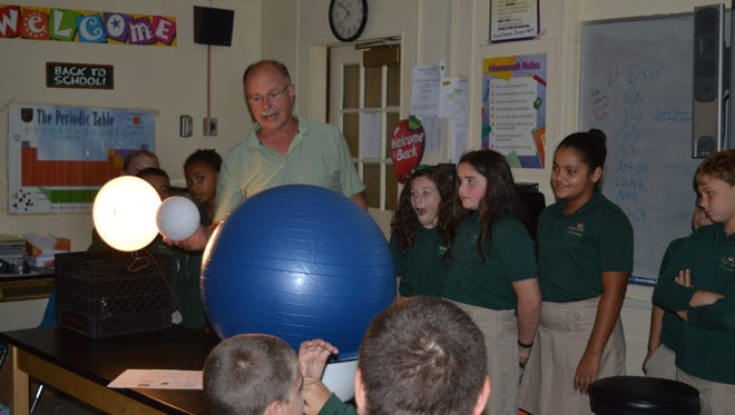 Barry Glogau, a retired science teacher and avid astronomer, recently joined science classes at Edgarton Christian Academy in Newfield to prepare children for the recent lunar eclipse. Using his props to demonstrate, Glogau explained to the children about using a telescope to view the eclipse. Glogau is pictured with fifth-graders (from left) Paris Colter, Carlina Fiocchi, Cami Cafiso, Nikki Guzman, Carlo Alimenti and Parker Swift.