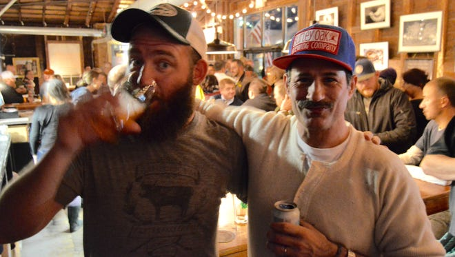 Bryan Brushmiller and Sam Calagione share a few laughs and beers at Burley Oak Brewing Company in Berlin. The two recently crafted a beer together, named Pants are Cumbersome.