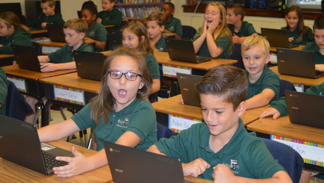 """(Front row, from left) Caleigh Ryan, 8, of Newfield, and T.J. Fiocchi, 9, of Vineland, and other members of Megan Maher's fourth-grade class at Edgarton Academy in Newfield learn about a new program, """"Keyboarding Without Tears."""""""