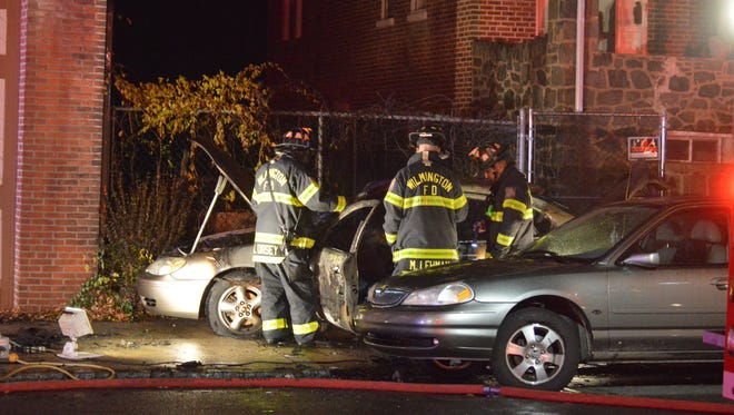 Wilmington firefighters at the scene of a predawn car fire Friday morning.
