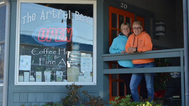 Rose O'Hanlan and Kim Warner smile in front of their coffee shop, the Artful Bean in Bethany Beach