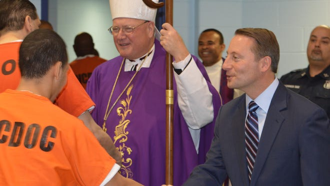 Westchester County Executive Rob Astorino, right, with Cardinal Timothy Dolan, greeted county inmates after the Advent Mass on Dec. 21 at the Westchester County jail.