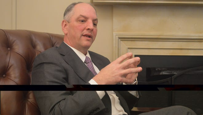 Gov. John Bel Edwards sits in the Lincoln Room of the U.S. Capitol Thursday after a meeting  with the Louisiana delegation.