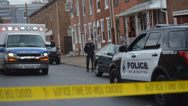 Police investigate a shooting in the 700 block of N. Monroe St. last month. The News Journal and WHYY are hosting the second in a series of Wilmington mayoral debates Thursday with a focus on public safety.
