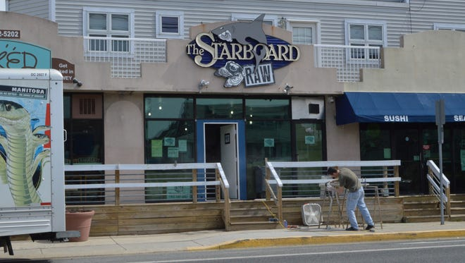A construction worker builds the railing for the Starboard Raw Bar, March 24.