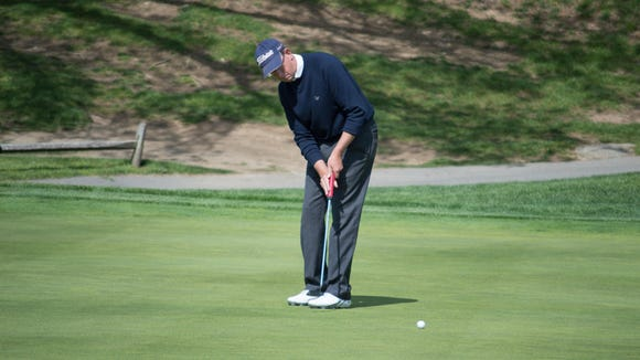 David Young of Sleepy Hollow Country Club watches his birdie putt on the 18th hole of the Mastercard Met PGA Senior Match Play Championship at Whippoorwill Club in Armonk, New York on May 12, 2016.