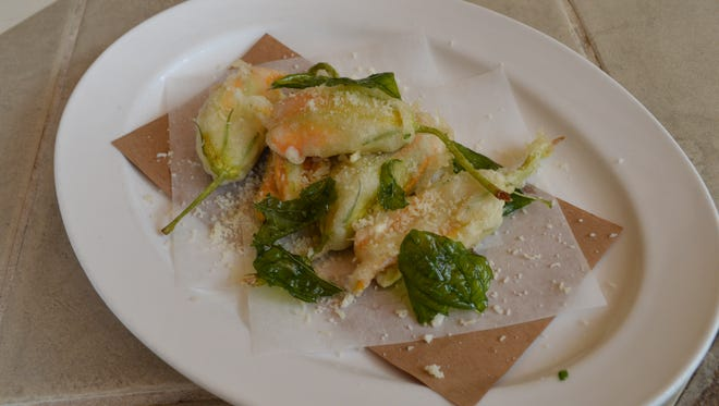 Squash blossoms with ricotta are on the regional Liguria menu.