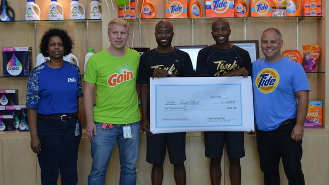 Tank Proof founders Torrence and Thurman Thomas accept a $10,000 dollar grant from Procter and Gamble. (pictured from left - Tammye Pettyjohn Jones, Vlastimil Krauz, Torrence Thomas, Thurman Thomas, and Colin Redhead)