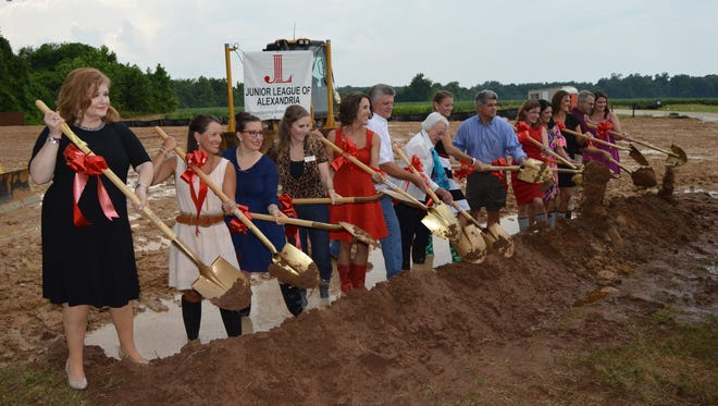 Community members came together to break ground for the Alexandria Junior League headquarters building on Wednesday.