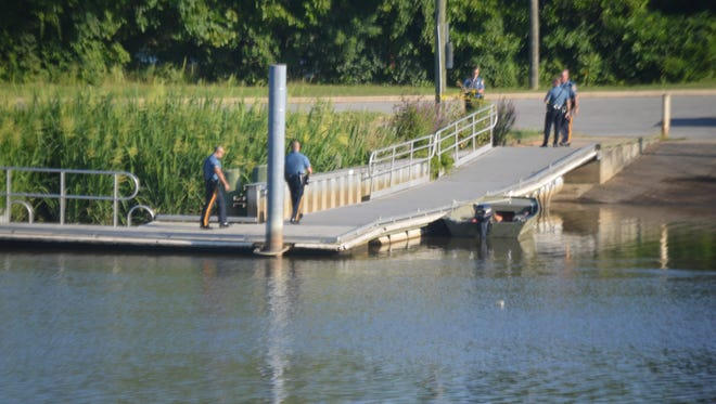 Police respond to a boat ramp on the Christina River in Newport on Saturday after a body was found. The incident is under investigation.
