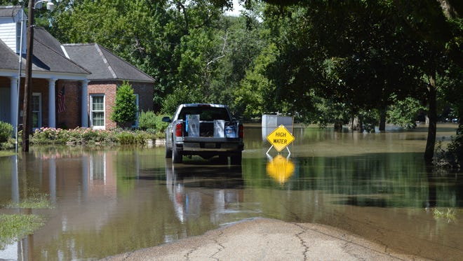 Some neighborhoods in Vermillion Parish remain under water nearly four days after torrential rains flooded the area.
