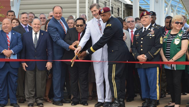 Cutting the ribbon at Parkway Elementary School, Aug. 18, 2016. (Pictured: Secretary of Louisiana Economic Development Don Pierson, Superintendent James Williams, Parkway Elementary Principal Elsee Ashworth, Karl Schneider, the Acting Assistant Secretary of the Army, and Brigadier General Gary Brito, the commanding general of Fort Polk)