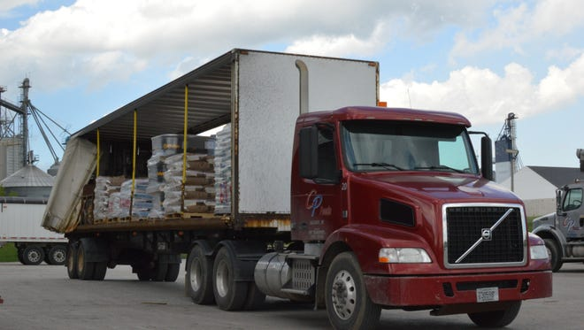 A delivery truck is loaded with animal feed at the CP Feeds mill in Valders.