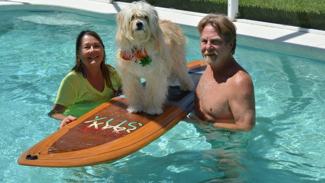 Waldo honed his surfing skills on a boogie board in the pool with Susan and Michael Leverette. Here they take a dip with the surfboard Michael made just for Waldo.