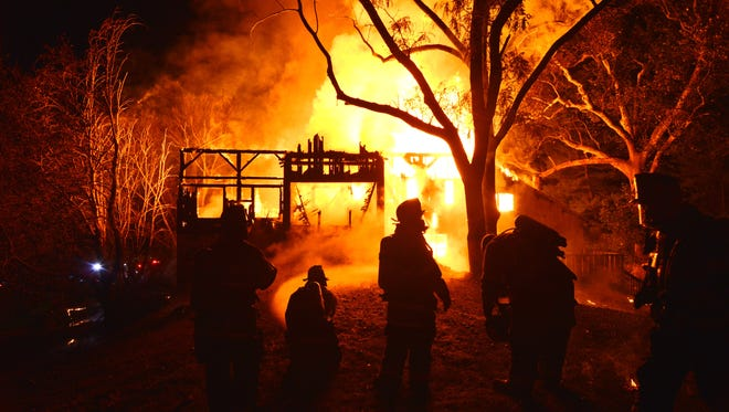 A fire burns a house in the 900 block of Crossan Road in North Star on Wednesday, Oct. 12, 2016.