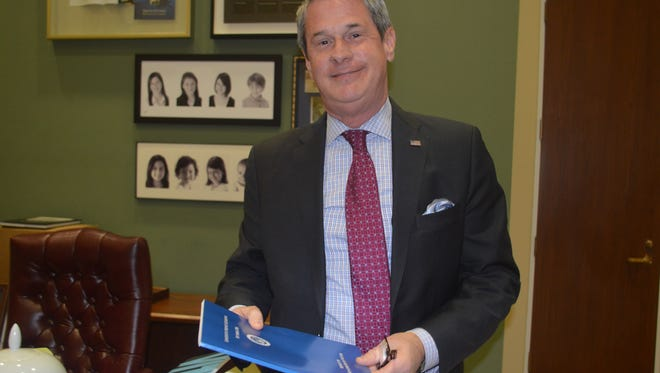 Sen. David Vitter, R-La., showed the Constituent Services Guidebook Tuesday he will share with his successor.