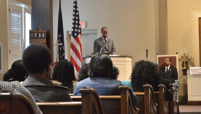Peter Dancy Jr., director of the Alexandria VA Health Care System, speaks to the crowd at a ceremony in the VA chapel on Friday, to commemorate the legacy of Dr. Martin Luther King, Jr.