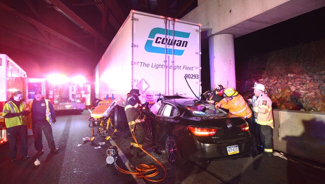 First responders work to rescue a person trapped in a car following an early Saturday crash on I-95 near the Chuchmans Road off ramp.