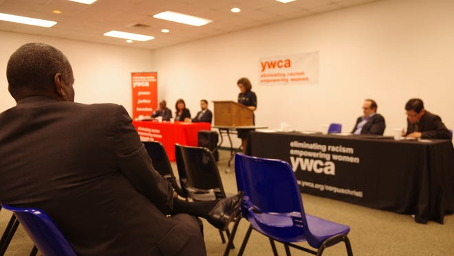 A couple dozen residents converged on the YWCA center on Corona Drive on Monday to talk about solutions to ending racism and discrimination in America.
