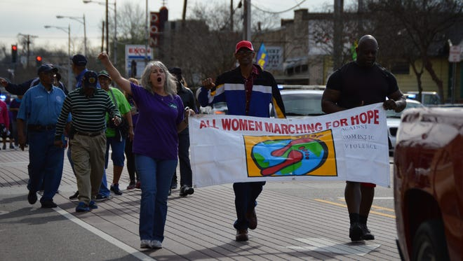 Dozens paraded down Bolton Ave. on Saturday morning to raise awareness about domestic violence in Central Louisiana.