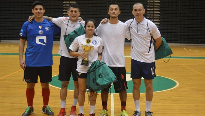 The Bash Squad finished first in the First Annual Co-Ed Futsal Tournament, which finished Jan. 22. It was hosted by the University of Guam Men's and Women's soccer team. Pictured from left are: John Reyes, Jonathan Romero, April Talledo, Ashton Surber and Jason Cunliffe. Not shown are Thomas Law, Marcus Lopez and Ricky Katsumata.