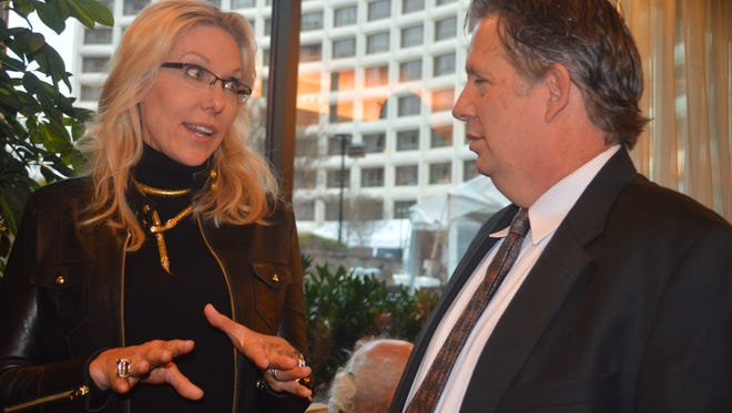 Monique Breaux of Lafayette chats with Lafayette Mayor-President Joel Robideaux Friday at the DC Mardi Gras.