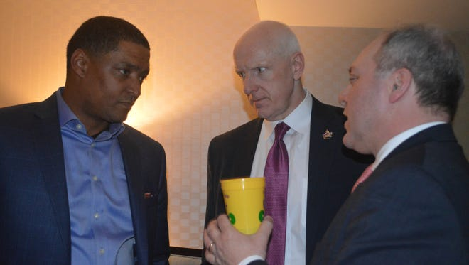Rep. Cedric Richmond, D-La., (left), Warner Thomas, president and CEO of Ochsner Health System and King of DC Mardi Gras,  and Rep. Steve Scalise, R-La., (right) chat at DC Mardi Gras Friday. The lawmakers pushed for federal aid to help  tornado victims.