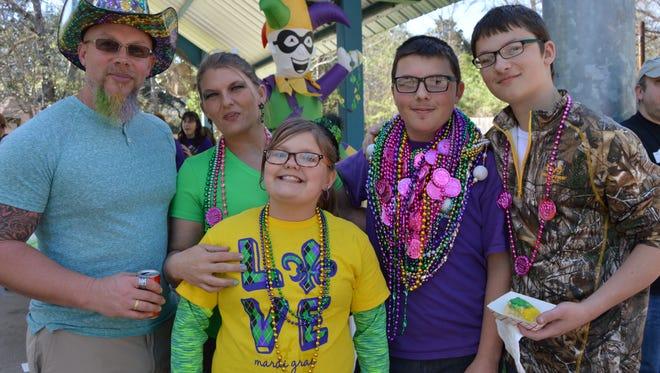 The Chapman family dressed to impress at Alexandria Zoo's Mardi Gras parade on Feb. 25.
